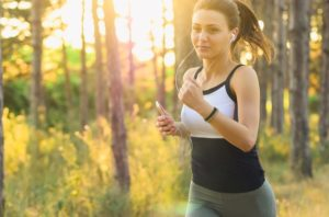 Girl running outdoors in sun